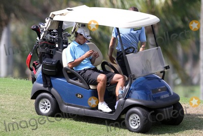 Alexandr Dolgopolov Photo - EXCLUSIVE Tennis ace Rafael Nadal plays a leisurely round of golf with is friend Silvio Garcia after making it to the quarterfinals of the Sony Ericsson Open Nadal who last night reportedly won and easy victory over Ukrainian Alexandr Dolgopolov in a match that lasted just under an hour appeared happy and relaxed on the golf course in Miami FL 33011Fees must be agreed prior to publication