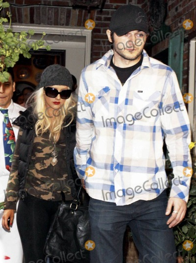 Christina Ha Photo - Christina Aguilera and boyfriend Matthew D Rutler hold hands as they leave The Ivy on New Years Eve Christina has reportedly been spending a lot of time with Matthew and her son Max after returning from the worldwide promotional tour for Burlesque 2010 was a big year for Christina that included her split from husband Jordan Bratman the release of her new album Bionic her film debut in Burlesque and her budding new relationship with Matthew Los Angeles CA 123110
