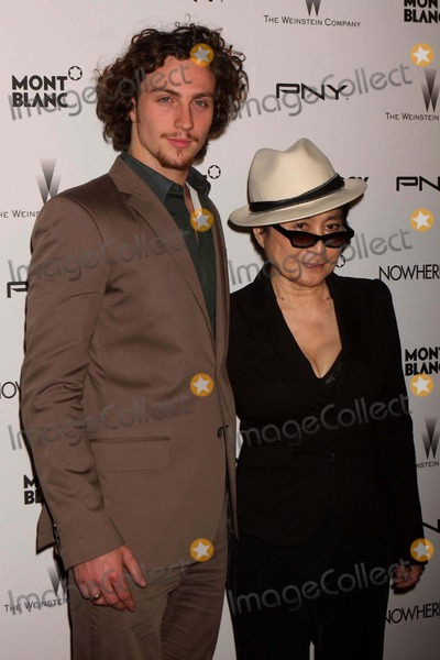 Aaron Johnson Photo - Aaron Johnson and Yoko Ono Arriving at the Premiere of the Weinstein Companys Nowhere Boy at the Tribeca Performing Arts Center in New York City on 09-21-2010 Photo by Henry Mcgee-Globe Photos Inc 2010