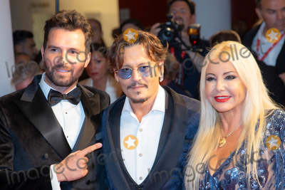 Andrea Iervolino Photo - VENICE ITALY - SEPTEMBER 06 Monika Bacardi Johnny Depp and Andrea Iervolino walks the red carpet ahead of the Waiting For The Barbarians screening during the 76th Venice Film Festival at Sala Grande on September 06 2019 in Venice Italy(Photo by Laurent KoffelImageCollectcom)