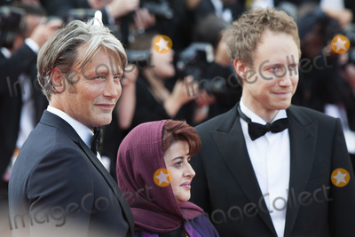 Laszlo Nemes Photo - CANNES FRANCE - MAY 16 Jury members Danish actor Mads Mikkelsen Iranian producer Katayoon Shahabi and Hungarian director Laszlo Nemes attends the Loving red carpet arrivals during the 69th annual Cannes Film Festival at the Palais des Festivals on May 16 2016 in Cannes France(Photo by Laurent KoffelImageCollectcom)