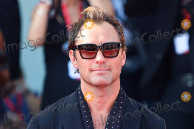 Jude Law Photo - VENICE ITALY - SEPTEMBER 01 Jude Law walks the red carpet ahead of The New Pope screening during the 76th Venice Film Festival at Sala Grande on September 01 2019 in Venice Italy(Photo by Laurent KoffelImageCollectcom)