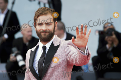 Alessandro Borghi Photo - VENICE ITALY - SEPTEMBER 09 Alessandro Borghi walks the red carpet ahead the Award Ceremony of the 74th Venice Film Festival at Sala Grande on September 9 2017 in Venice Italy(Photo by Laurent KoffelImageCollectcom)