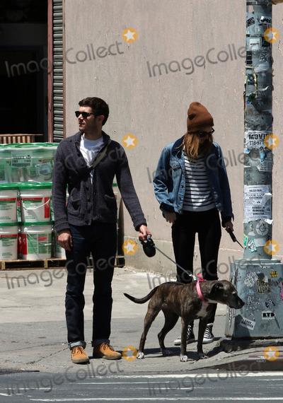 Adam Brody Photo - May 29 2014 New York CityActress Leighton Meester and her husband Adam Brody walk their dogs near Soho on May 29 2014 in New York City
