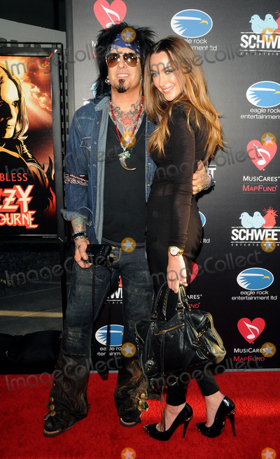 Nikki Sixx Photo - Musician Nikki Sixx and Courtney Bingham arriving at a Screening Of God Bless Ozzy Osbourne To Benefit The Musicares Map Fund at the Arclight Cinemas Hollywood on August 22 2011 in Hollywood California