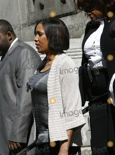 Hotel Maids Photo - The hotel maid who accused former IMF director Dominique Strauss-Kahn of sexual assault Nafissatou Diallo (C) with her legal team follwing a meeting at the Manhattan District Attorneys office on August 22 2011 in New York City All charges against Dominique Strauss-Kahn are set to be dropped