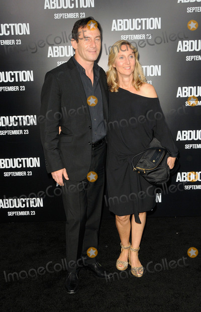 John Isaacs Photo - John Isaacs and wife arriving at the Los Angeles premiere of Abduction at Graumans Chinese Theatre on September 15 2011 in Hollywood California