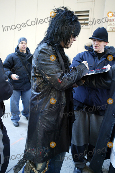 Nikki Sixx Photo - NEW YORK MARCH 3 2005    Motley Crue member Nikki Sixx signs autographs and poses for pictures while exiting an appearance on Live with Regis and Kelly