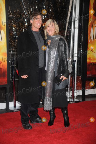 Olivia Newton-John Photo - Olivia Newton John (Right) and husband John Easterling  attends the Australia Premiere held at the Ziegfeld Theater on November 24 2008 in New York City