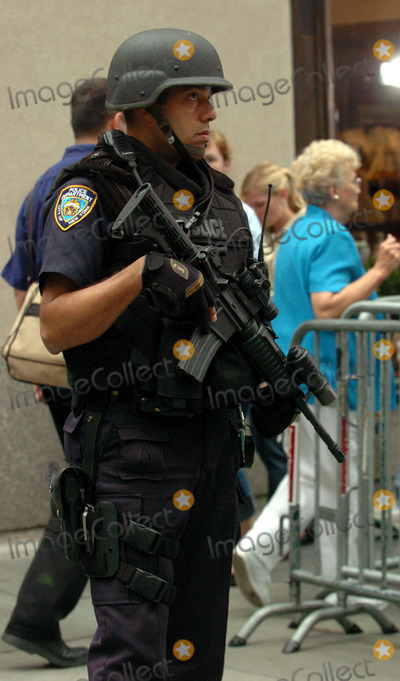 ARMED POLICE Photo - Specialist emergency Police units are being seen more frequently at public performances in New York City to provide increased levels of security These well-armed cops were in attandance at the NBC Today Show summer concert series in Rockafeller Plaza New York May 14 2004