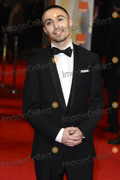 Adam Deacon Photo - Adam Deacon arriving for the BAFTA Film Awards 2012 at the Royal Opera House Covent Garden London 12022012  Picture by Steve Vas  Featureflash