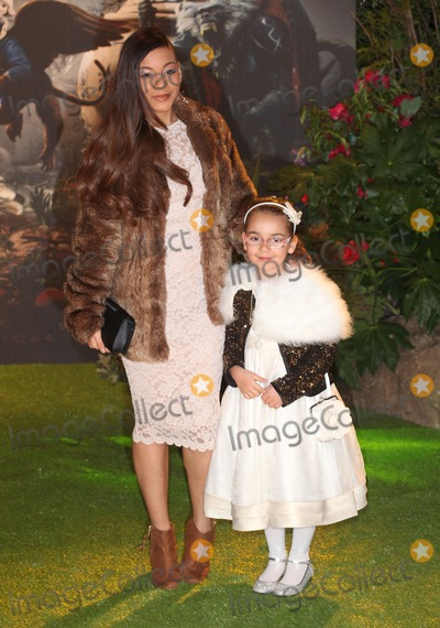 Jade Ellis Photo - Jade Ellis and daughter arriving for the UK Premiere of Oz The Great And The Powerful Empire Leicester Square London 28022013 Picture by Alexandra Glen  Featureflash