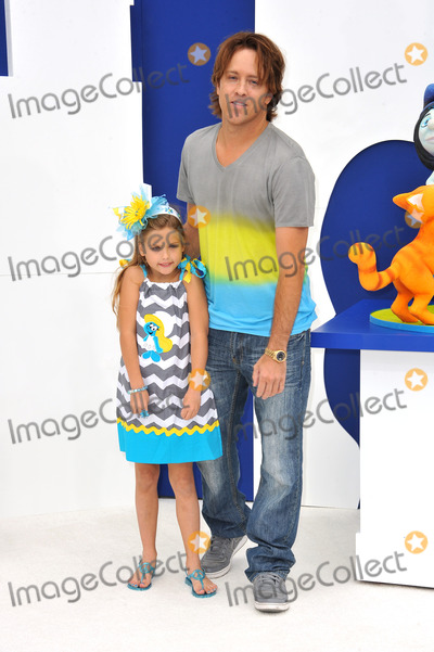 Anna Nicole Smith Photo - Larry Birkhead  Dannielynn Marshall (daughter of the late Anna Nicole Smith) at the Los Angeles premiere of The Smurfs 2 at the Regency Village Theatre WestwoodJuly 28 2013  Los Angeles CAPicture Paul Smith  Featureflash