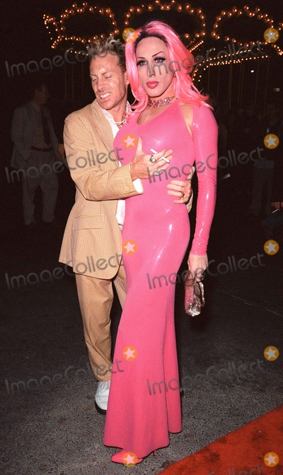Alexis Arquette Photo - 24SEP99 Transvestite actor ALEXIS ARQUETTE (brother of Patricia  David Arquette) with friend CANDYASS (thats the name he gave) at the opening of Cirque du Soleils new show Dralion in Santa Monica CA Paul Smith  Featureflash