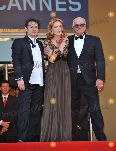 Nadezhda Mihalkova Photo - Director Nikita Mikhalkov (glasses) actress Nadezhda Mihalkova  actor Artem Menshikov at the premiere of their movie Exodus - Burnt by the Sun at the 63rd Festival de CannesMay 22 2010  Cannes FrancePicture Paul Smith  Featureflash
