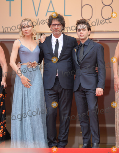 Xavier Dolan Photo - Sienna Miller Joel Coen  Xavier Dolan at the closing gala at the 68th Festival de CannesMay 24 2015  Cannes FrancePicture Paul Smith  Featureflash