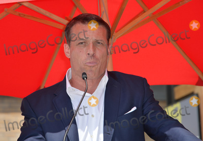 Tony Robbins Photo - LOS ANGELES CA July 15 2016 Motivational speaker Tony Robbins on Hollywood Blvd where singer Pitbull was honored with the 2584th star on the Hollywood Walk of FamePicture Paul Smith  Featureflash