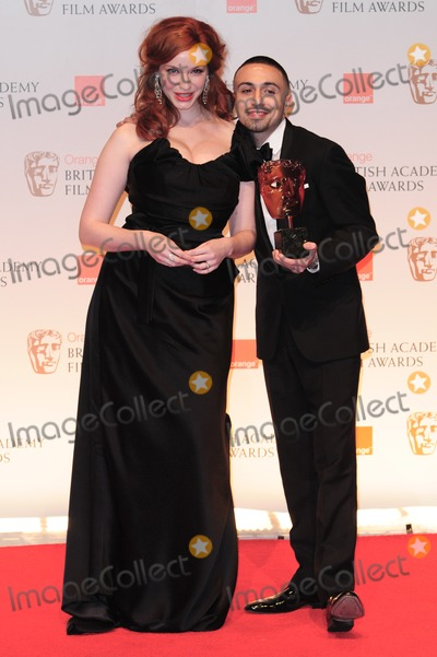 Adam Deacon Photo - Christina Hendricks and Adam Deacon in The Winners Room at the 2012 BAFTAs Royal Opera House Covent Garden London 12022012 Picture by Simon Burchell  Featureflash