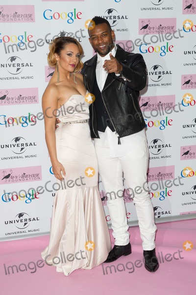Amy Winehouse Photo - Oritse Williams and girlfriend arriving for the Amy Winehouse Foundation Dinner London 20112013 Picture by Dave Norton  Featureflash