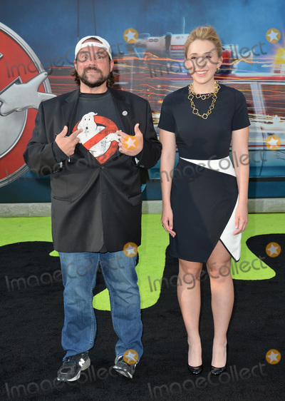 Jennifer Schwalbach Smith Photo - LOS ANGELES CA July 9 2016 Actor writer producer Kevin Smith  wife actress Jennifer Schwalbach Smith at the Los Angeles premiere of Ghostbusters at the TCL Chinese Theatre HollywoodPicture Paul Smith  Featureflash