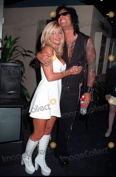 Nicki Sixx Photo - 10JUL97  Baywatch star DONNA DERRICO  husband Motley Crue guitarist NICKI SIXX at the Video Software Dealers Assoc convention in Las Vegas