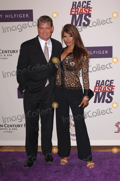 Traci Bingham Photo - Actress TRACI BINGHAM  husband JOHN EDWARD YARBROUGH at the 12th Annual Race to Erase MS Gala themed Rock  Royalty to Erase MS at the Century Plaza HotelApril 22 2005  Beverly Hills CA 2005 Paul Smith  Featureflash