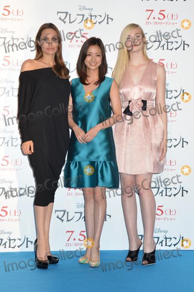 Aya Ueto Photo - Angelina Jolie Aya Ueto Elle Fanning  06242014 Maleficent Press Conference Photocall held at Grand Hyatt Tokyo in Tokyo Japan Photo by Kazumi Nakamoto  HollywoodNewsWirenet