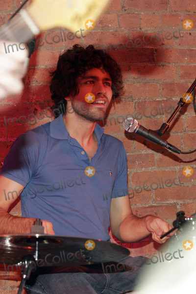 Honey Brothers Photo - Actor Adrian Grenier playing drums onstage with The Honey Brothers during the big party celebrating the launch of the new Big TV Guide on October 11  2005 in New York City