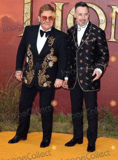 Sir Elton John Photo - London UK Sir Elton John David Furnish the European Premiere of The Lion King held at Odeon Leicester Square London on Sunday 14 July 2019   Ref LMK392-J5174-150719Vivienne VincentLandmark Media WWWLMKMEDIACOM