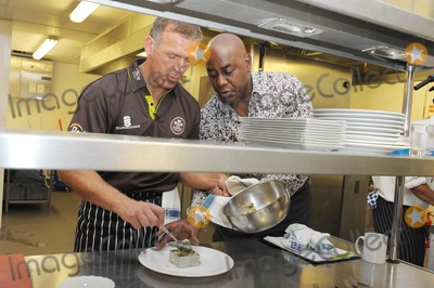 Ainsley Harriott Photo - London UK  Ainsley Harriott (chef) Alec Stewart (former England cricket captain and now BBC cricket commentator) and Chris Garrett (Oval cricket ground head chef) take part in a cook-off to promote food available during the upcoming and final Ashes test match of this series held at the Oval Surrey County Cricket Club in Kennington12 August 09Ali KadinskyLandmark Media