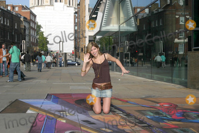 Julian Beever Photo - London Coronation Street star Nikki Sanderson with 3D pavement chalk drawing of Spiderman by artist Julian Beever for the release of the new Spiderman X-Box game16 October 2005Art KarinaLandmark Media