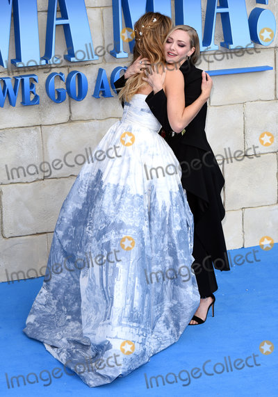 Amanda Seyfried Photo - London UK Lily James and Amanda Seyfried at The World Premiere of Mamma Mia Here We Go Again held at Eventim Apollo Hammersmith on Monday 16 July 2018Ref LMK392-J2320-170718Vivienne VincentLandmark Media WWWLMKMEDIACOM