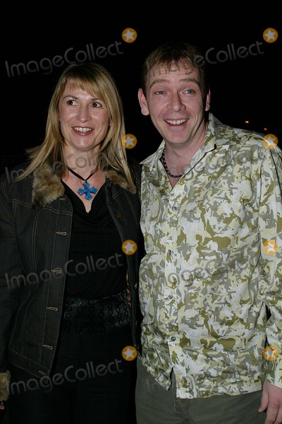 Adam Woodyatt Photo - London EastEnders star Adam Woodyatt who plays Ian Beale in the show  arrives at the Shane Ritchie party in West London with his partner 13th March 2004 Ref ALEXANDRELANDMARK MEDIALMK