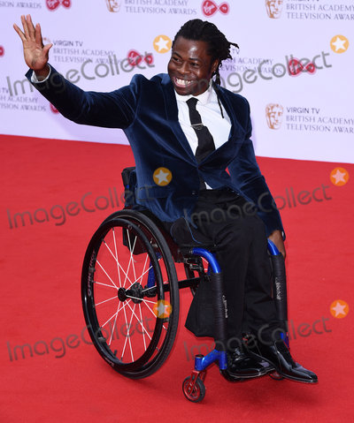 Ade Adepitan Photo - London UK  Ade Adepitan at The Virgin TV British Academy (BAFTA) Television Awards 2017 held at The Royal Festival Hall Belvedere Road London on Sunday 14 May 2017Ref LMK392-J277-150517Vivienne VincentLandmark Media WWWLMKMEDIACOM