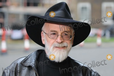 Terry Pratchett Photo - London UK   Writer Terry Pratchett  (the author of the Discworld comic book fantasy series) delivers a petition to the British Prime Miniser Gordon Brown in Downing Street  The petition is on behalf The Alzheimers Research  Trust to increase  money spent on this health issue Pratchett has been involved in promoting research on this brain disease following his own admission that he was now suffering from the same affliction 26th November 2008 Matt LewisLandmark Media
