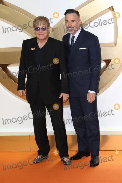 Sir Elton John Photo - London UK Sir Elton John and David Furnish at the Kingsman The Golden Circle World Premiere held at Odeon Leicester Square on September 18 2017 in London EnglandRef LMK73-J756-190917Keith MayhewLandmark MediaWWWLMKMEDIACOM