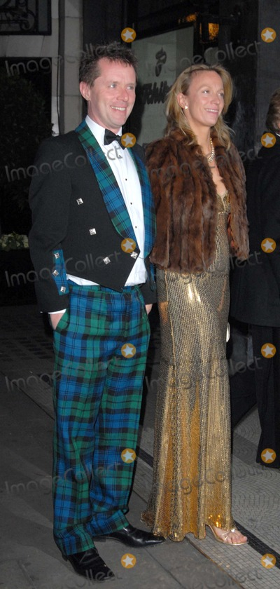 Nicky Campbell Photo - LondonUK TV and radio presenter Nicky Campbell (in his tartan suit) and wife Tina  at the British Association of Adoption and Fostering gala dinner Park Lane Hotel London 28th February 2008 SydLandmark Media