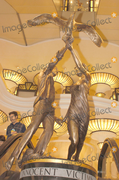 DODI AL-FAYED Photo - London A statue commenorating the lives of the late Diana Princess of Wales and Mohammed Al Fayeds son Dodi who died eight years ago in a car crash in Paris  The bronze statue stands at the entrance of the exclusive London store Harrods which Mr Al Fayed owns  It stands 10ft tall and has been named Innocent Victims  The dancing couple are holding an albatross the most romantic and mysterious of seabirds symbolising freedom and eternity01 September 2005Ali KadinskyLandmark Media