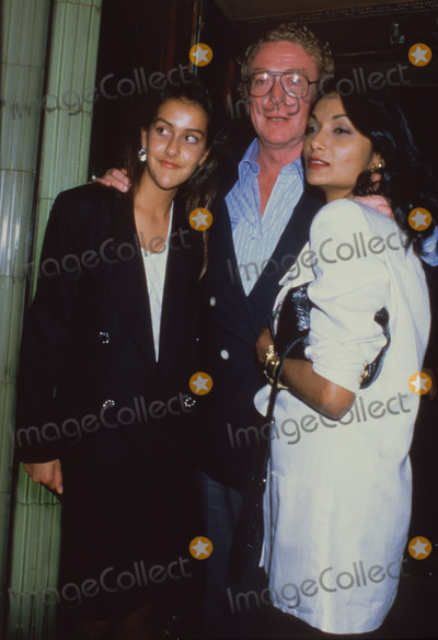 Michael Cain Photo - London UK LIBRARY Michael Caine with wife Shakira Caine (right) and daughter Natasha Caine Mid 1990s ReCap10072020RefLMK11-SLIB100720-001  PIP-Landmark MediaWWWLMKMEDIACOM