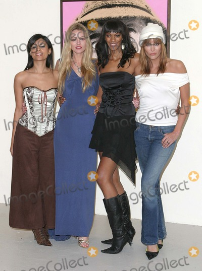 Aruna Shields Photo - London Aruna Shields Natasja Vermeer Judi Shekoni and Catalina Guirado at the Private Moments photocall at the Apart Gallery13 December 2004Paulo PirezLandmark Media