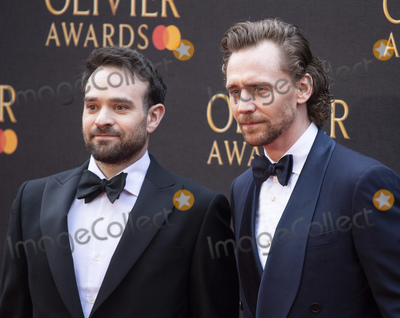 Tom   Hiddleston Photo - London UK Charlie Cox and Tom Hiddleston  at The Olivier Awards 2019 with Mastercard at Royal Albert Hall on April 7 2019 in London England 7th April 2019Ref LMK386-J4701-080419Gary MitchellLandmark MediaWWWLMKMEDIACOM