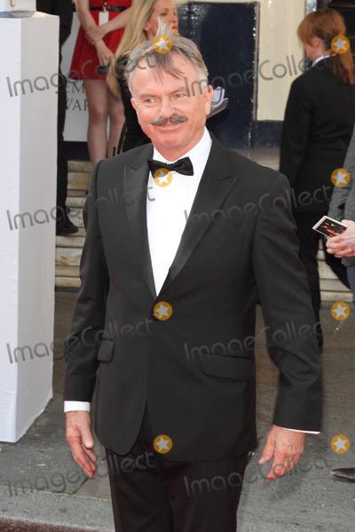 Sam Neill Photo - London UK Sam Neill  at the Arqiva BAFTA Television Awards Red carpet arrivals at the Theatre Royal Drury Lane London on 18th May 2014RefLMK73-48511-190514 Keith MayhewLandmark MediaWWWLMKMEDIACOM