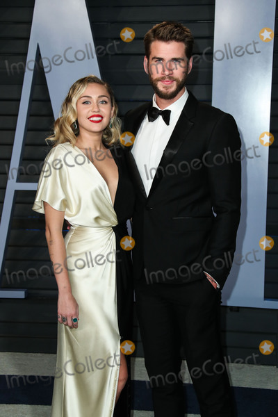 Wallis Annenberg Photo - (FILE) Miley Cyrus and Liam Hemsworth Donate 500000 to Emergency Relief After Losing Home in California Wildfires Miley Cyrus and Liam Hemsworth lost their home to a California wildfire but the famous couple have their sights set on rebuilding not just their house but also their community Cyrus and Hemsworth have donated 500000 to The Malibu Foundation through Cyrus charity Happy Hippie a representative said The funds will be used for those in financial need emergency relief assistance community rebuilding  wildfire prevention and climate change resilience according to a statement Earlier on Tuesday Hemsworth shared a striking photo of their homes remains BEVERLY HILLS LOS ANGELES CA USA - MARCH 04 Singer Miley Cyrus and boyfriendactor Liam Hemsworth arrive at the 2018 Vanity Fair Oscar Party held at the Wallis Annenberg Center for the Performing Arts on March 4 2018 in Beverly Hills Los Angeles California United States (Photo by Xavier CollinImage Press Agency)