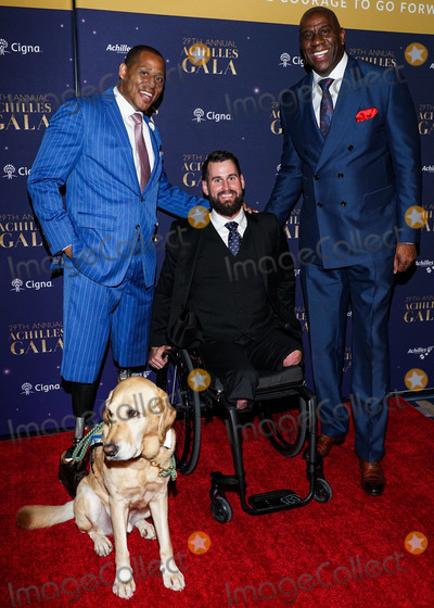 Magic Johnson Photo - MANHATTAN NEW YORK CITY NEW YORK USA - NOVEMBER 20 Cedric King Stefan LeRoy and Magic Johnson arrive at the 29th Annual Achilles Gala held at Cipriani South Street on November 20 2019 in Manhattan New York City New York United States (Photo by William PerezImage Press Agency)