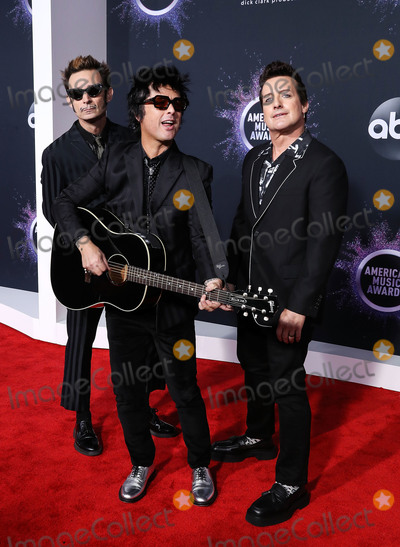 Joe Corr Photo - LOS ANGELES CALIFORNIA USA - NOVEMBER 24 Mike Dirnt Billie Joe Armstrong and Tre Cool of Green Day arrive at the 2019 American Music Awards held at Microsoft Theatre LA Live on November 24 2019 in Los Angeles California United States (Photo by Xavier CollinImage Press Agency)
