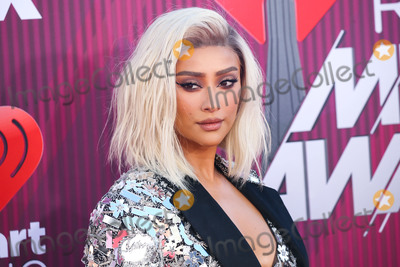 Shay Mitchell Photo - LOS ANGELES CA USA - MARCH 14 Actress Shay Mitchell wearing a Nicolas Jebran dress and jacket As29 earrings Julien Macdonald shoes and carrying a Tyler Ellis clutch arrives at the 2019 iHeartRadio Music Awards held at Microsoft Theater at LA Live on March 14 2019 in Los Angeles California United States (Photo by Xavier CollinImage Press Agency)