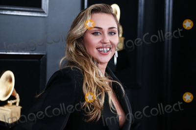 Grammy Awards Photo - (FILE) Miley Cyrus Helps MAC Announce a 10 Million Donation for Coronavirus COVID-19 Pandemic Relief LOS ANGELES CALIFORNIA USA - FEBRUARY 10 Singer Miley Cyrus wearing a Mugler outfit and Loree Rodkin jewelry arrives at the 61st Annual GRAMMY Awards held at Staples Center on February 10 2019 in Los Angeles California United States (Photo by Xavier CollinImage Press Agency)