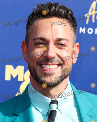 Zachary Levi Photo - SANTA MONICA LOS ANGELES CALIFORNIA USA - JUNE 15 Actor Zachary Levi wearing a Paul Smith suit Anto shirt Christian Louboutin shoes and a Montblanc watch arrives at the 2019 MTV Movie And TV Awards held at Barker Hangar on June 15 2019 in Santa Monica Los Angeles California United States (Photo by Xavier CollinImage Press Agency)