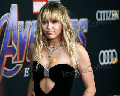 Miley Cyrus Photo - (FILE) Miley Cyrus Helps MAC Announce a 10 Million Donation for Coronavirus COVID-19 Pandemic Relief LOS ANGELES CALIFORNIA USA - APRIL 22 Singer Miley Cyrus wearing Saint Laurent arrives at the World Premiere Of Walt Disney Studios Motion Pictures and Marvel Studios Avengers Endgame held at the Los Angeles Convention Center on April 22 2019 in Los Angeles California United States (Photo by Xavier CollinImage Press Agency)
