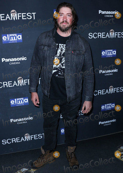 The Darkness Photo - HOLLYWOOD LOS ANGELES CALIFORNIA USA - OCTOBER 17 Actor Tanner Beard arrives at the Screamfest Closing Night Screening Of We Summon The Darkness held at TCL Chinese 6 Theatres on October 17 2019 in Hollywood Los Angeles California United States (Photo by Xavier CollinImage Press Agency)